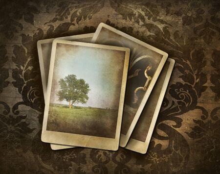 old notebook: Vintage photos on dark damask background Stock Photo
