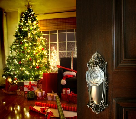 Door opening into a beautiful living room decorated for Christmas photo