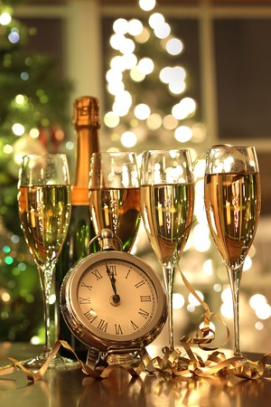 Four glasses of champagne ready for the countdown to the New Year photo
