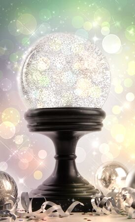 Snow globe with ornaments against a colored background Stock Photo - 8163265