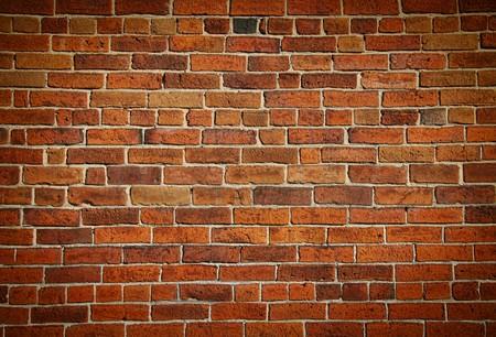 Verweerde gebeitst oude bak stenen muur achtergrond
