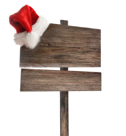 Weathered wooden sign with Santa hat on white background Stock Photo - 8163273