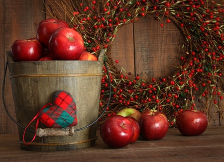 Red apples in wood bucket for holiday baking photo