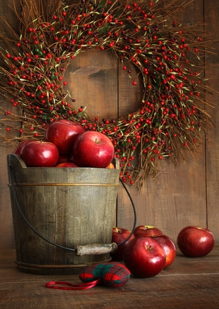 Wooden bucket of apples for the holidays photo
