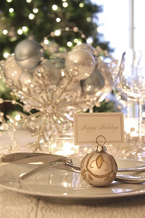 decoration: Elegantly lit holiday dinner table with focus on place card Stock Photo