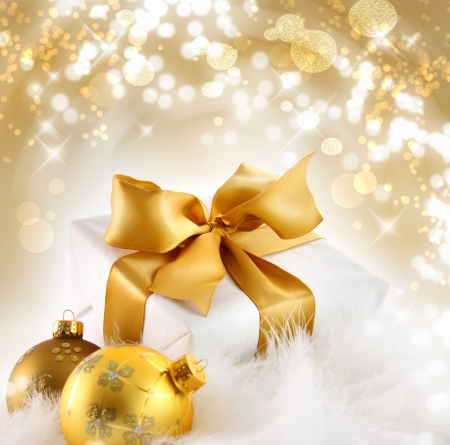 Gold ribbon gift with festive holiday background Stock Photo