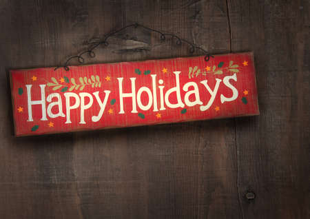 distressed: Holiday sign on distressed wooden wall Stock Photo