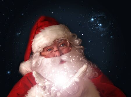 fulfillment: Santa holding magical Christmas lights in hands Stock Photo