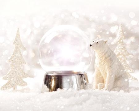 Snow globe in  winter scene photo