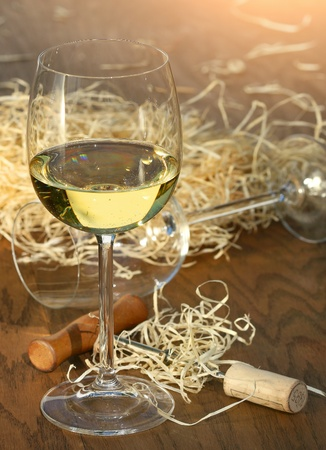 Glass of white wine with cork screw on table Stock Photo - 8423565