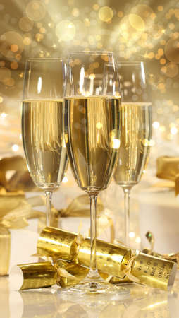 Glasses of champagne and gifts for new years celebrations