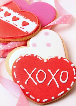 Heart-shape cookies for Valentines Day with ribbons