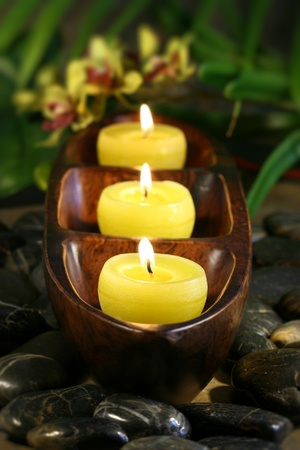 Spa candles with rocks for aromatherapy feeling Stock Photo - 8911239