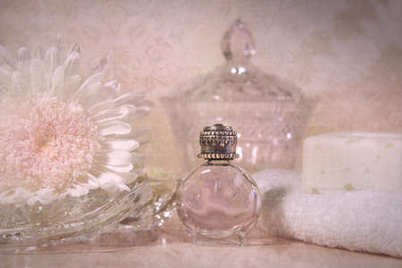 Vintage perfume bottle with flower and soap photo