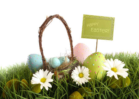 greenfield: Easter eggs with  basket in the grass Stock Photo