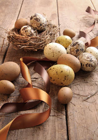 decoration: Brown and yellow speckled eggs with ribbons for easter Stock Photo
