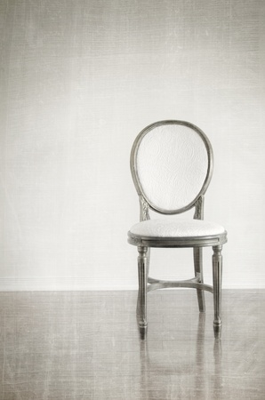 Antique chair with vintage grunge background photo