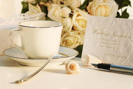 Taking a break for tea and writing wedding invitation  photo