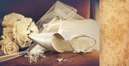 Wedding shoes with veil  on velvet chair photo