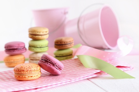 Delicious French Macaroons with ribbons on table