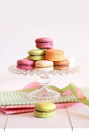 French macaroons on cake tray with vintage background Imagens