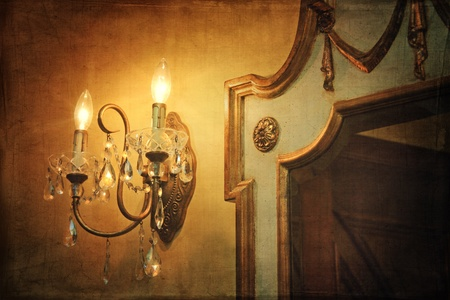 sconce: Antique wall light sconce with mirror and vintage background Stock Photo