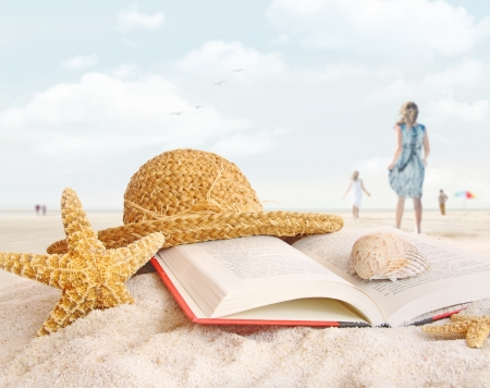 note book: Straw hat , book and seashells on the beach with people walking Stock Photo