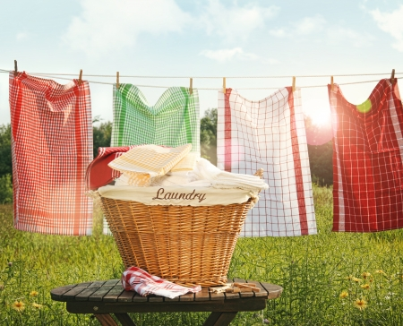summer clothing: Cotton towels drying on the clothesline with sunny  sky
