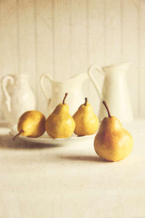 Fresh pears on old wooden table with vintage feeling photo