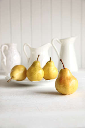Fresh pears on old wooden table photo