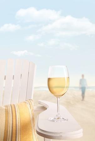 Glass of white wine on adirondack chair photo