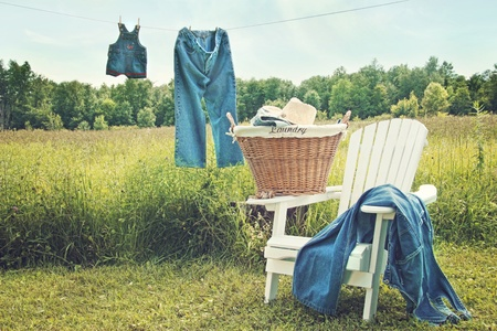 Jeans hanging on clothesline on a sunny summer afternoon Stock fotó