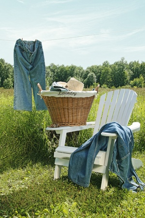 Jeans hanging on clothesline with blue sky photo