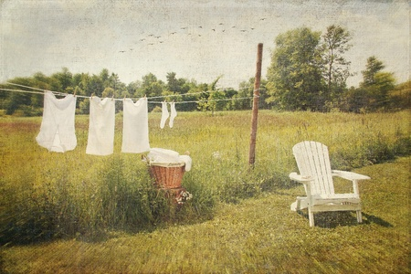 to the line: White cotton clothes drying on a wash line with vintage feel