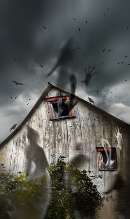 Haunted old barn with ghosts flying and dark skies photo