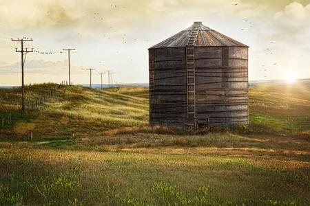 Abandoned wood grain storage bin on the prairies in Saskatchewan, Canada photo