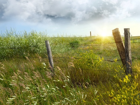 Old country fence on the prairies in Saskatchewan photo