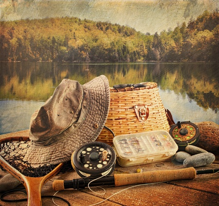 Fly fishing equipment on deck with a vintage look Foto de archivo