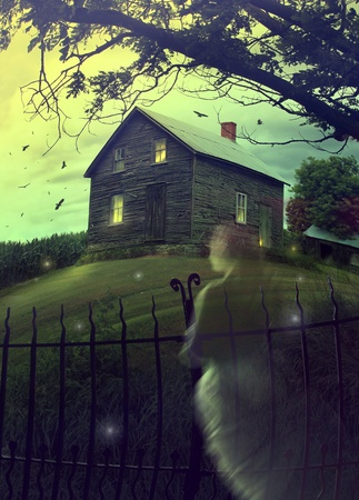Abandoned haunted house on a hillside with ghost Stock Photo