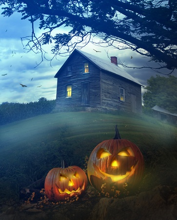 haunted house: Halloween pumpkins in front of a Spooky house Stock Photo
