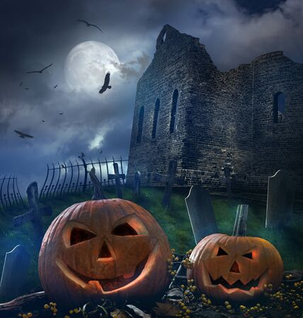 Spooky pumpkins in graveyard with church ruins
