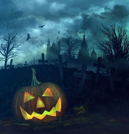 treat: Halloween pumpkin in a spooky graveyard Stock Photo