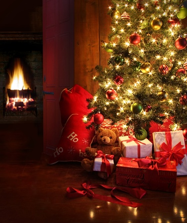 christmas background: Christmas scene with tree  gifts and fire in background