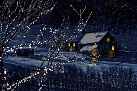 Snowy winter scene of a cabin in distance at night 스톡 콘텐츠