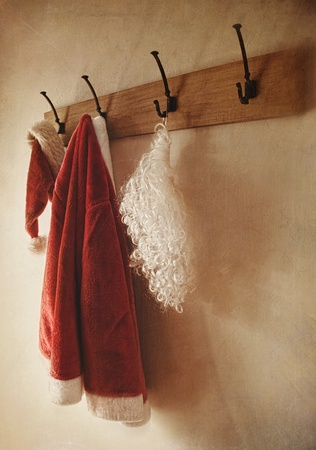 Santa costume hanging on coat rack with vintage look