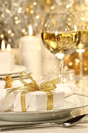 buffet dinner: Little gold ribbon gift with gold background