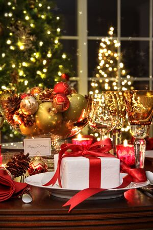 dine: Festive dinner table setting with red ribbon gift