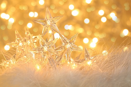 Star holiday lights with gold sparkle background