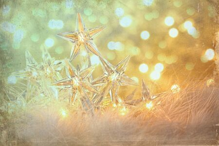 Vintage holiday lights with sparkle background Stock Photo