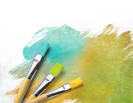 artist palette: Artist brushes with a half finished painted color canvas